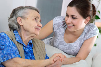 caregiver-helping-elderly-woman-350